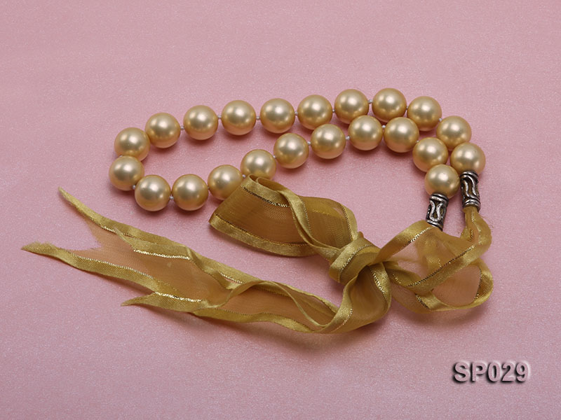 12mm golden round seashell pearl necklace with golden riband big Image 3